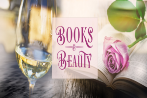 wine glass next to an open book with a rose on it.