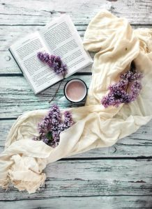 lace and lilacs surrounding coffee and a book