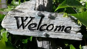 welcome sign surrounded by leaves